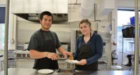 Students cook in professional kitchen at Bishop Smith Catholic High School