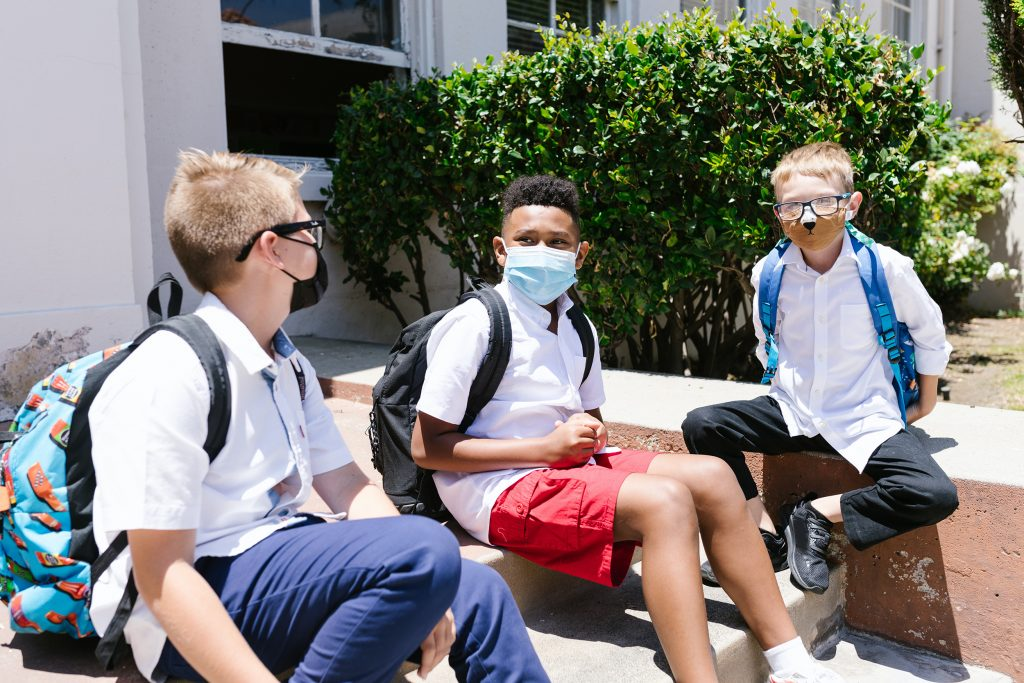 Group of friends wearing face masks